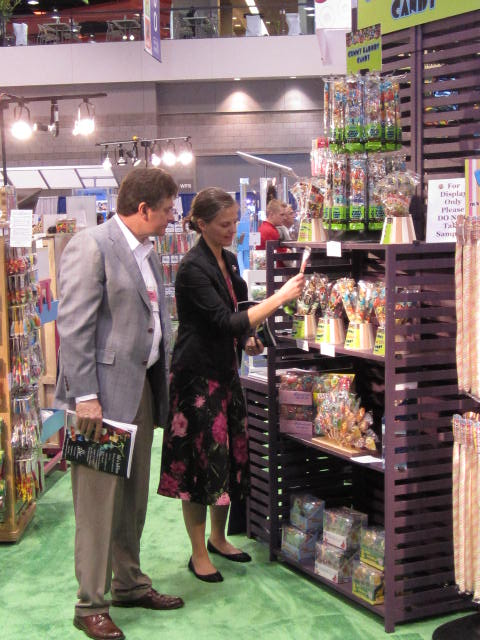 COO, Alen Conway and Suzanne Conway view the Gummy Kabobs Candy - Squire Boone Village at NCA Sweets and Snacks Expo